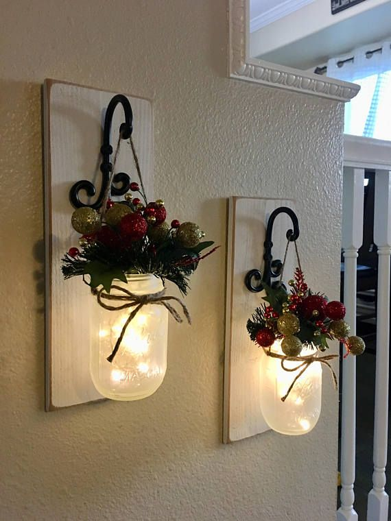 This is a beautiful set of 2 or 3 mason jar wall sconces. It includes two sconces, hanging mason jars and flowers. The sconce measures 14 tall and 5.5 wide. Jars are pint size. FLOWERS AND LIGHTS BATTERY OPERATED FAIRY LIGHTS INCLUDED!! Scroll through the listing to see your