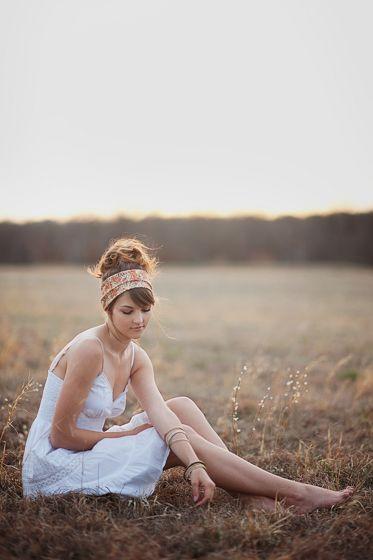 boho chic sitting in a field