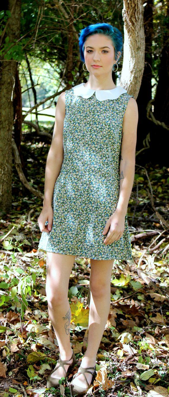 d2f09eb865 Cute 1960 s inspired shift dress. Blue with all over tiny floral print.  Sleeveless.