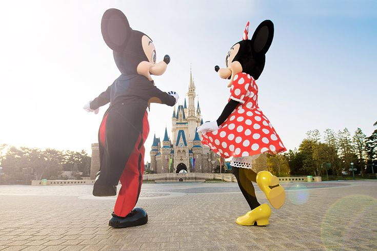 Mickey & Minnie hopping and skipping their way back to Cinderella Castle at Tokyo Disneyland