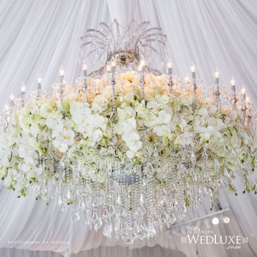 Gorgeous Flowers Mixed With A Magnificent Chandelier