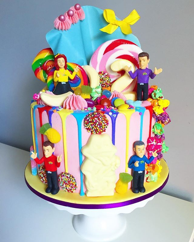 Happy birthday, Halle! Hope you're ready to WIGGLE! ❤️ Chocolate fudge cake with #nutella buttercream filling topped in a #candyland version of Wiggle Town. Check out my instastory for a 360 shot video of the cake! @thewiggles #thewiggles #wigglescake