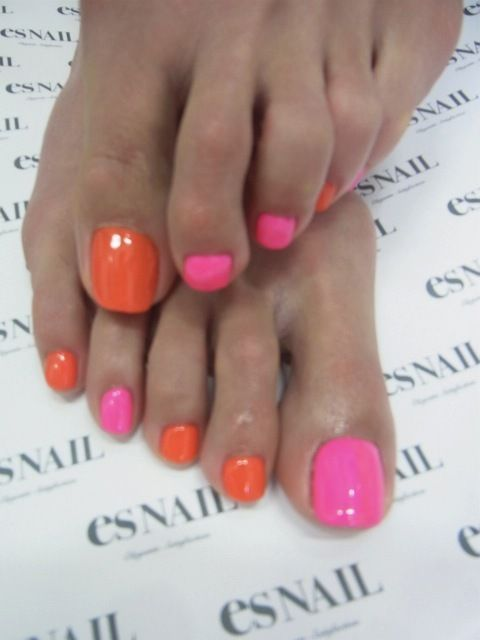 nails hot pink and neon orange.  Must do this summer.