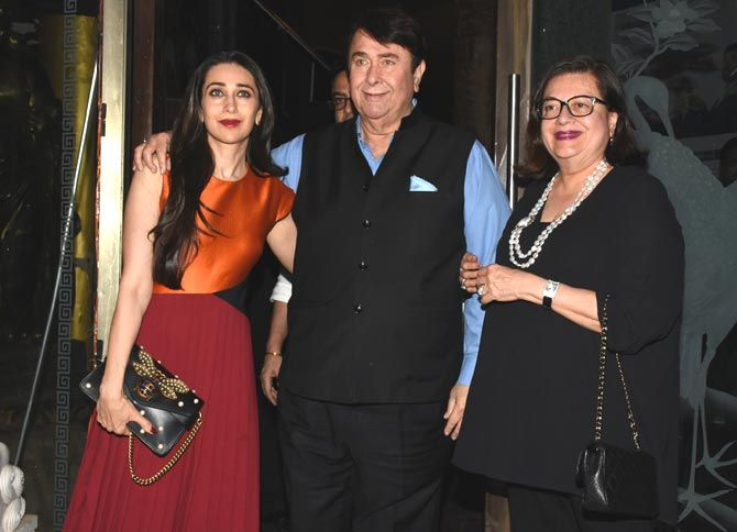 Randhir Kapoor (C) poses with wife Babita (R) and daughter Karisma Kapoor (L) after his birthday celebrations in Bandra, Mumbai. Pics/Yogen Shah : Kareena, Karisma, Babita and family celebrate Randhir Kapoor's birthday