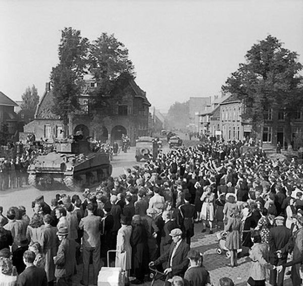 Sherman tanks advancing through cheering crowds in Valkenswaard, the Netherlands, 18 Sep 1944