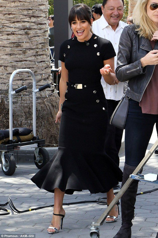 That dress! The 30-year-old star was styled in a black peplum dress, adorned with silver p...