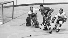 In October, 1967, Gordie Howe, the Detroit Red Wings great, contends with California Seals goalie Charlie Hodge and defenceman Bob Baun. (Preston Stroup/AP) http://www.theglobeandmail.com/sports/hockey/fifty-years-ago-the-nhl-expanded-and-pro-hockey-changed-forever/article28825593/