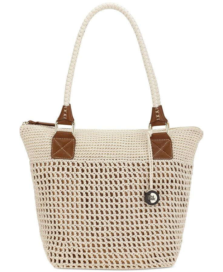 Go easy and breezy with this chic crochet carryall from The Sak. Topped with slender braided handles and a logo charm, the generous interior stashes it all. | Imported | Polypropylene | Double handles