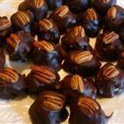 1 c. pecans, 1/2 c. soft butter, 1# powdered sugar, 1 1/2 # semi-sweet chocolate, Makers. Soak nuts in bourbon, make balls, refrigerate, dip
