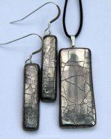 Rectangular platinum lustre crackled  pendant with long earrings.