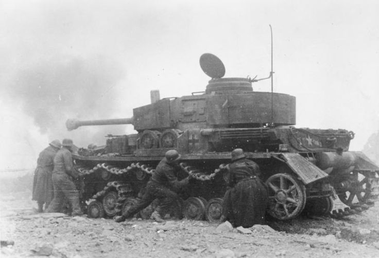 Battle of Monte Cassino, Italy, Jan 1944: The crew of this disabled Panzer is feverishly trying to repair a blown track while under fire. Manhandling hundreds of kilos of steel into place is a hard job under ideal conditions, let alone under machine gun fire. Fortunately for the Panzer troops, their tank provides cover while the job proceeds.