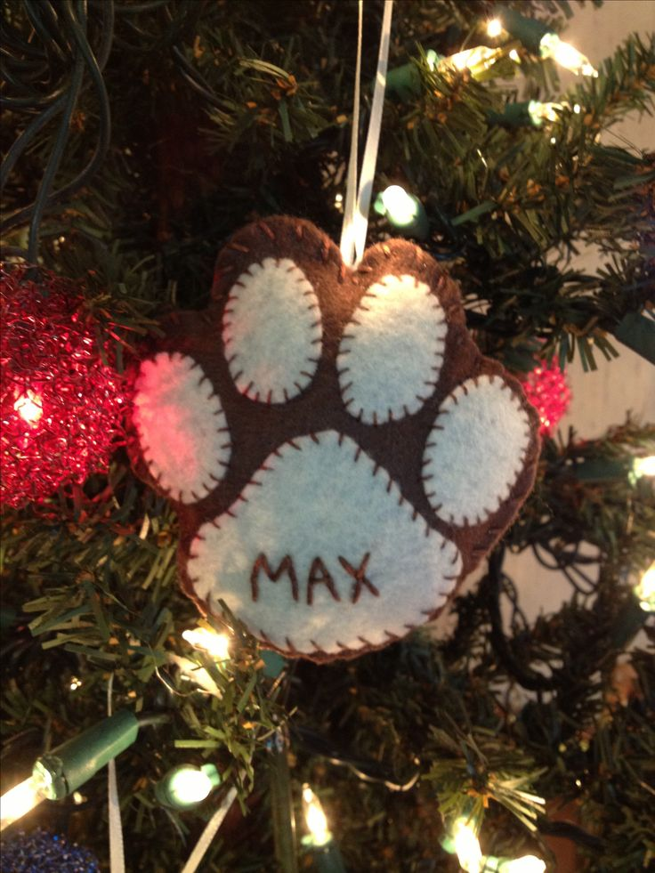 Felt Ornament for the Pooch And all of the Pooches of the past....note: I could not find a pattern for this since it was just a picture upload but here is a link to pawprint outlines you can use as a pattern..LINK:http://search.aol.com/aol/image?q=PAWPRINT+OUTLINE