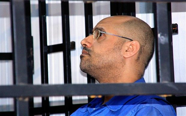 Saif al-Islam Gaddafi: Muammar Gaddafi's Son Sentenced to Death in Libya  Read more: http://www.bellenews.com/2015/07/28/world/africa-news/saif-al-islam-gaddafi-muammar-gaddafis-son-sentenced-to-death-in-libya/#ixzz3hBlyndzv Follow us: @bellenews on Twitter | bellenewscom on Facebook
