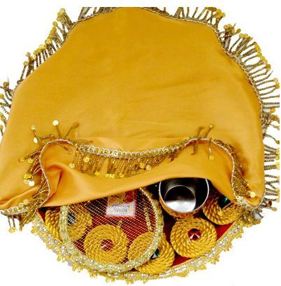 Karwachauth Pooja Thali that beholds Stainless Steel Thali (Diameter- 11 inches). Comes with a stainless-steel glass for the holy water. A panchmukhi diya with a Batti with four steel katories embedded on the thali!!
