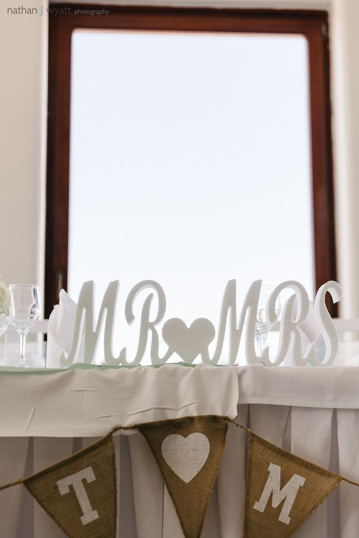 Summer wedding in Santorini, Greece. wedding decoration: black Sand from the beach, for the guests to rememer!