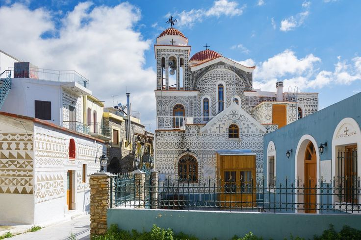 72. Admire the ornate patterns on the houses and church in the village of Pyrgi, on the Greek island of Chios.