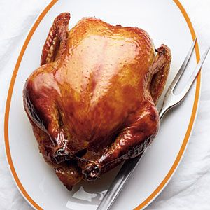 Fantastic Bourbon Smoked Chicken  (Site noted: To reinforce the whiskey flavor in the brine and basting butter, use Jack Daniel's whiskey barrel chips for smoking--widely available in grill and gourmet shops.)