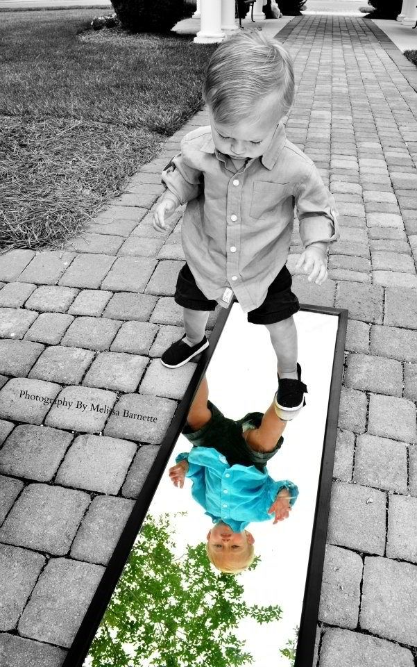 Black and white with a splash of color to make the focal point, which was the boy, to the mirror reflection of him.