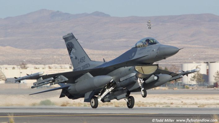F-16 Lobos landing.1st of 2015's 4 Red Flags at Nellis,Jan.26-Feb.13 with 2 mission windows flown each day.Each mission involves approx.60-70 a/c with each type representing specific capability set utilized to accomplish objectives.Divided in Red Air (hostile) & Blue Air (friendly).Red Air primarily 64th Aggressor Sqdn of Nellis flying F-16s & F-15Cs,trained to use tactics representing hostile forces.In this Red Flag F-15Es from Seymour Johnson represented ground attack for Red Air.