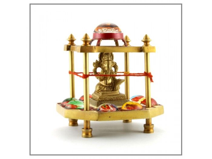 "AshtaVinayak Yantra Chowki for Ganesh chaturthi VedicVaani.com. Ganepati throne, brass desktop items, home decor, prayer vessels purchase on best price.   A powerful yantra Chowki with Lord Ganesha brass idol in the center surrounded by eight forms of Lord Ganesha and a Ganesh yantra on the top, set on a pedestal with four pillars.  Eight Swayambhu idols of lord Ganesha or commonly known as ""ASHTAVINAYAKAS"" to all of us, is the most visited pilgrimage in western maharashtra, by people of all"