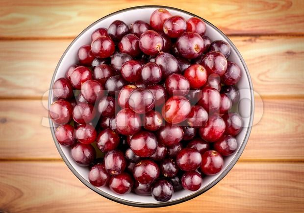 Stock photo of Juicy red grapes in bowl from $1.99. Find high quality images from independent artists at Symzio.