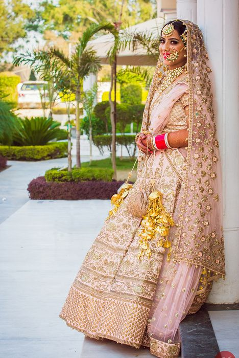 Real Indian Wedding - Khushbeen and Gurlal | WedMeGood | Bride in a Blush Pink Heavy Embroidered Lehenga with a Net Embroidered Dupatta and Gold Kaleere  #wedmegood #indianwedding #bridal #blushpink