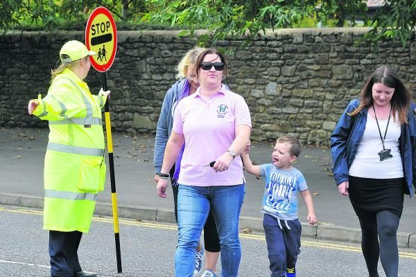 Highworth Town council waste several thousand pounds per year on a new role of a lollipop lady along Brewery Street, Highworth, because parents and children are so lazy / uneducated that they cannot use the traffic light crossing less than 20 meters down the road.