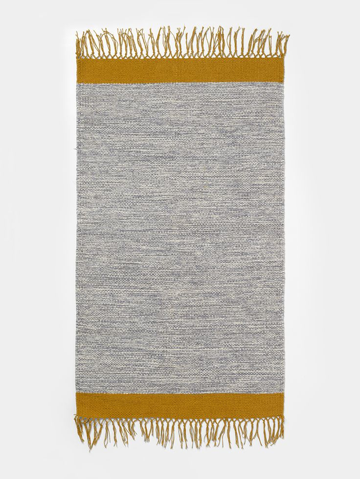 Step out of the shower and onto the melange bathroom rug in a rich cotton quality with a sharp graphic detail