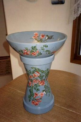 I'll have to try making one of these out of terra cotta pots... want one for the middle of my herb garden:)