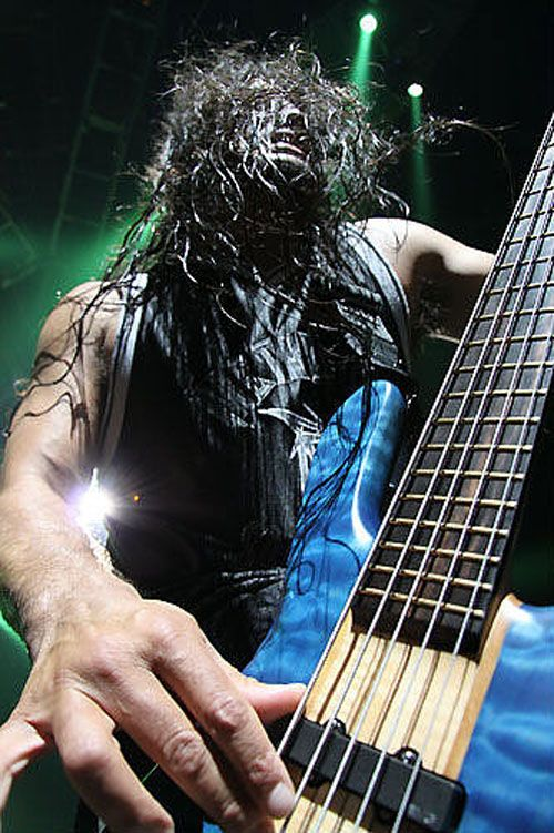 Robert Trujillo, love it when he stomps around the stage :) He looks like a madman here, but remember he is also an awesome husband and father...and probably a big teddy bear at home!