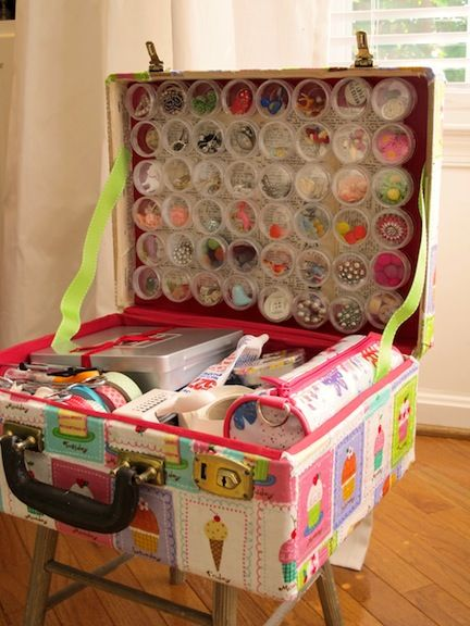 Supplies Holder For those who travel with craft supplies and/or use a lot of small items, this revamp is perfect The clear containers are glued to magnets and attach to a cookie sheet installed in the suitcase lid.