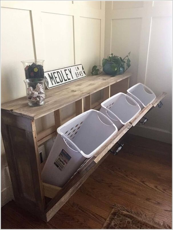 Make a Sorter for Your Landry Room with a Pallet Frame and Plastic Bins