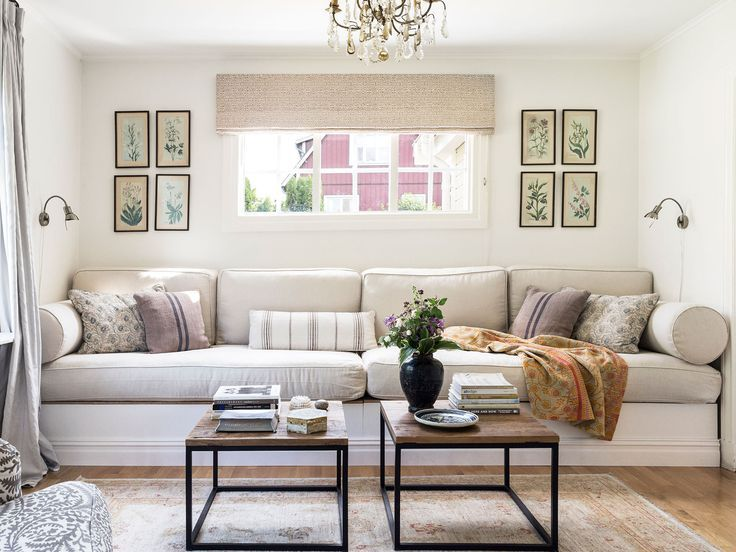 A 12-foot custom sofa is outfitted in washable slipcovers with generous storage hidden below.