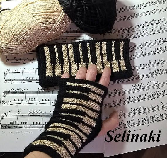 Hand knit gold glitter piano fingerless gloves.  Handmade by me with 100% Acrylic yarns.  They are flexible and one size fits all.  Ready to ship.  Free shipping with another item.  For the matching hat please visit https://www.etsy.com/listing/516821544/knit-golden-piano-keyboard-knit-music  For the matching scarf please visit https://www.etsy.com/listing/530219141/knit-golden-piano-scarf-black-and-gold  For my other music items please visit ...