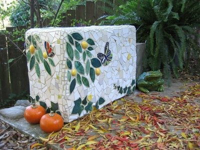 A mosaic bench created from a styrofoam box.