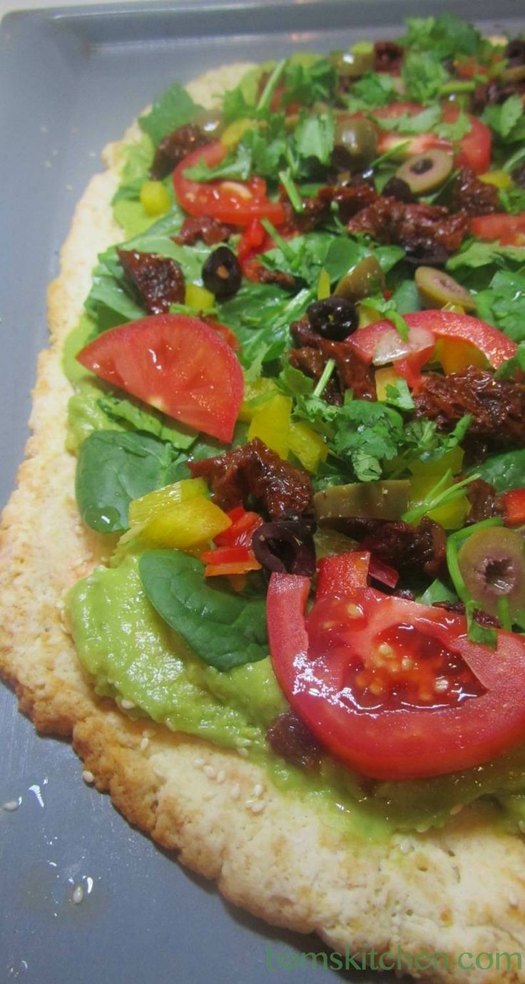 Wholly guacamole pizza Pizzazz. It is like eating a dip, salad and pizza all at once. Gluten free, lactose free, vegan friendly and a perfect way to bring in a healthy New Year.