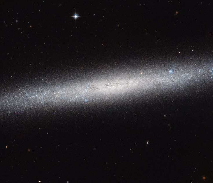 Hubble Views a Galaxy on Edge | This NASA/ESA Hubble Space Telescope image shows an edge-on view of the spiral galaxy NGC 5023. Due to its orientation we cannot appreciate its spiral arms, but we can admire the elegant profile of its disk. The galaxy lies over 30 million light-years away from us.