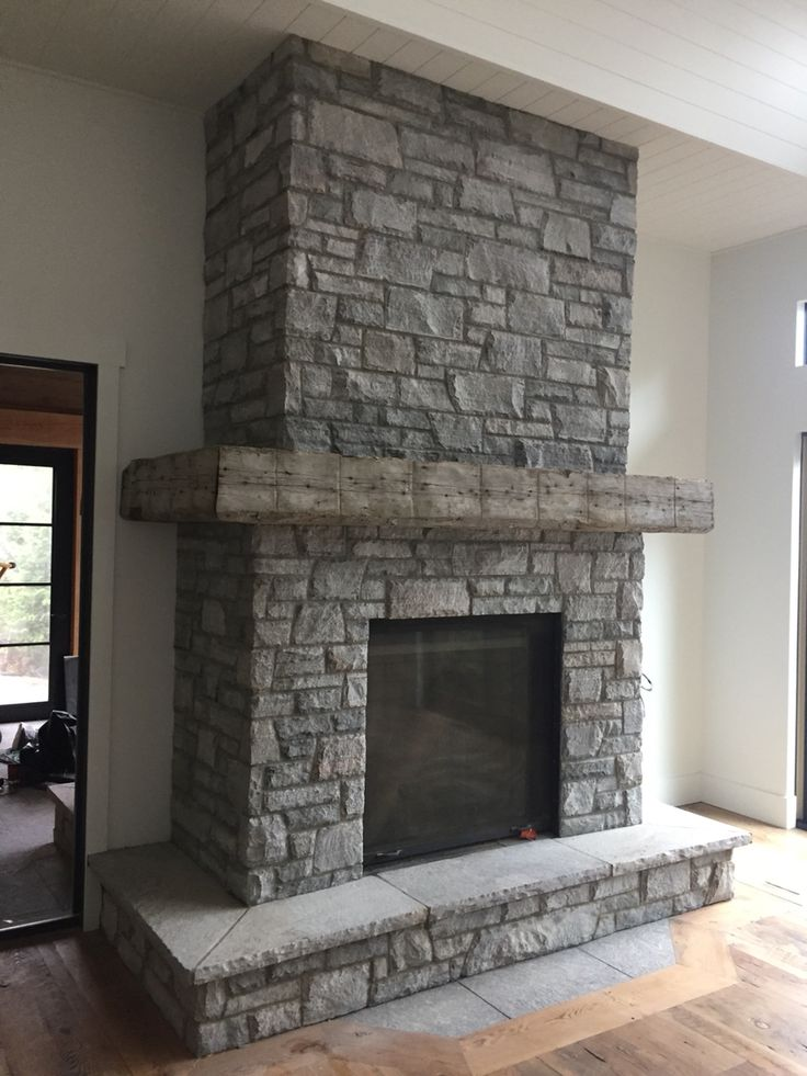 Muskoka granite Ashlar medium grey mix. Complete with barn beam timber mantel. Another project by:  Saunders Stone Design