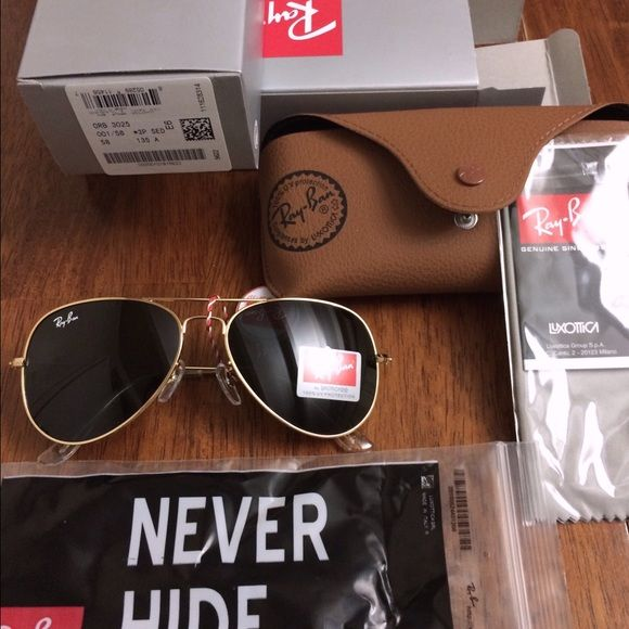 Ray ban Aviator RB3025 Chrome lens/ Silver Frame Ray ban RB3025 Black lens/ Gold Frame size 58 medium, brand new in box, exactly as in the pictures. Ray-Ban Accessories Sunglasses