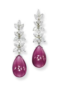A pair of ruby and diamond ear pendants. photo Christie's Ltd 2010    Each designed as a drop-shaped cabochon ruby suspended from a line of marquise-shaped and brilliant-cut diamond clusters,