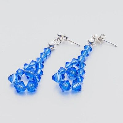 Swarovski Bicone Earrings 45mm Sapphire  Dimensions: length: 4,5cm stone size: 4 and 6mm Weight ( silver) ~ 0,90g ( 1 pair ) Weight ( silver + stones) ~ 3,90g Metal : sterling silver ( AG-925) Stones: Swarovski Elements 5328 4 & 6mm Colour: Sapphire 1 package = 1 pair  Price 7 EUR