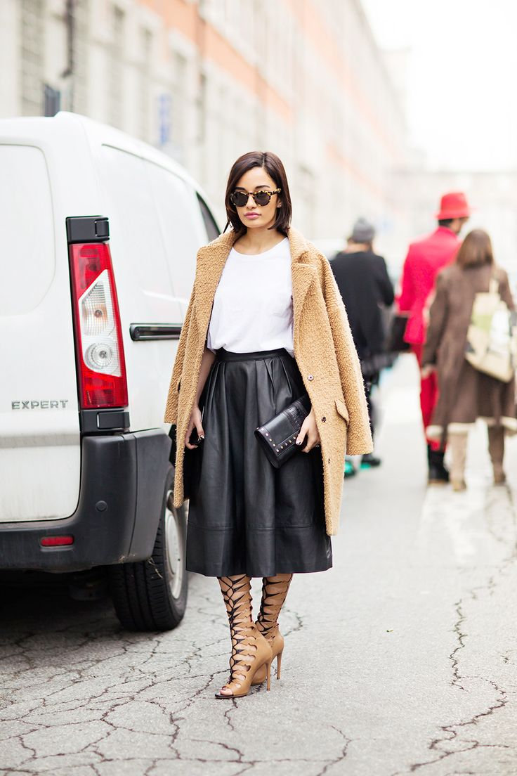Midi skirts can be edgy    Obsessed with the styling here  black leather skirt  nude lace up sandals  and a camel coat  StreetStyle