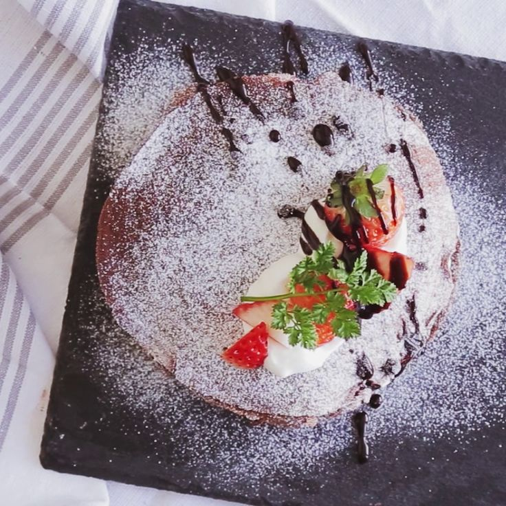 Recipe with video instructions: How to make Chocolate Mille Crepe Ingredients: 1 extra-large egg, 1 cup milk, 4 tbsp sugar, 3 tbsp unsweetened cocoa powder, 1/2 cup+1 tbsp flour, 15 strawberries, mint, chocolate syrup, 1/2 cup heavy cream + 1 1/2 tbsp sugar