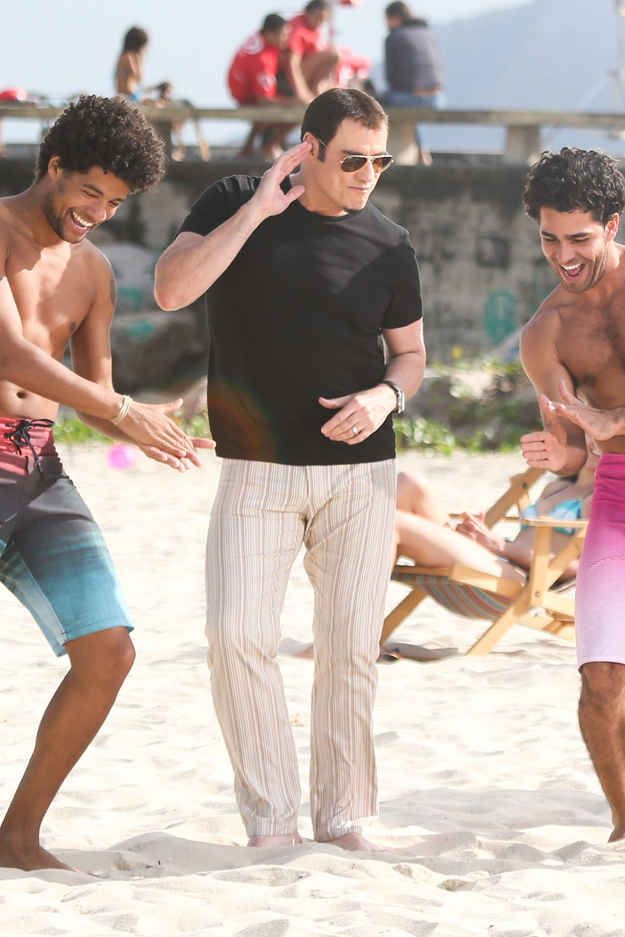 John Travolta Danced On A Beach With Some Half-Naked Men
