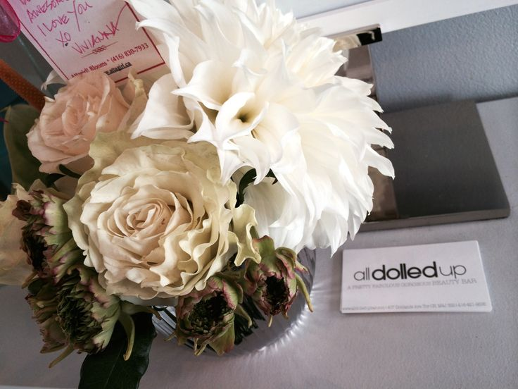 Corporate Blooms: All Dolled Up (Beauty Bar). Floral Sentiment: Anthurium (Hospitality), Dahlia (Dignity), Ranunculus (Radiant + Charming), Roses (Love)
