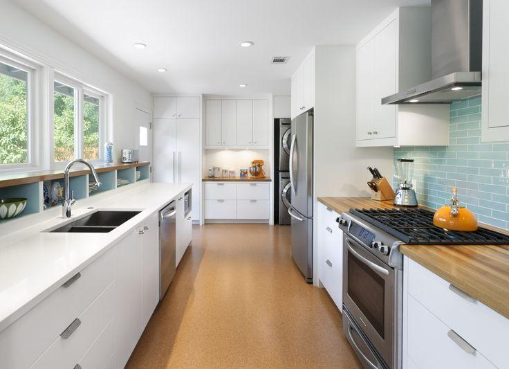 white, blue & wood modern galley kitchen | Cultivate.com #kitchen