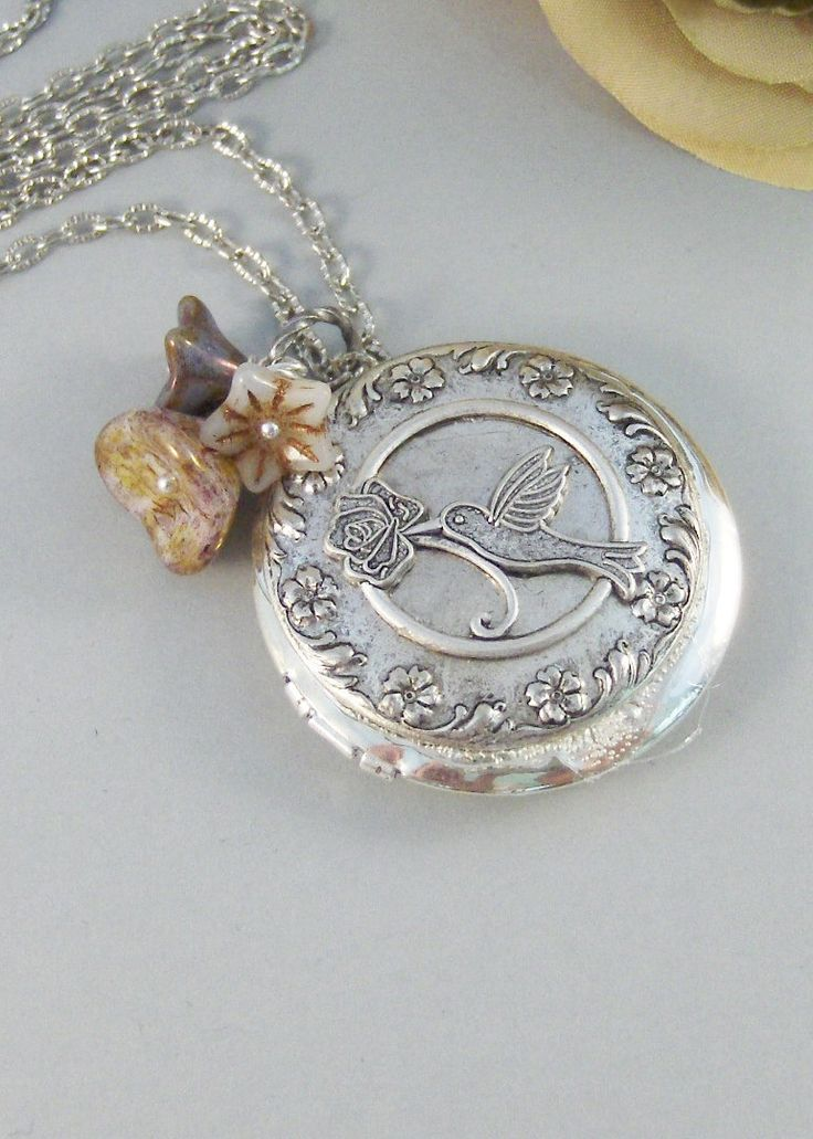 Hummingbird,Locket,Silver Locket,Flower,Bird,Purple,Ivory,Antique Locket,Floral,Jewelry. Handmade jewelry by valleygirldesigns.. $33.00, via Etsy.