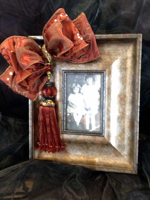 Ideas for embellishing frames, if you'd rather DIY.  http://theelegantdoor.com/wp-content/gallery/lucia-design-frames/copper-2.jpg