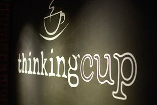 10 Unique Coffee Shops in USA: lovely simply logo design, friendly and approachable as the type style are in lowercase. i also like the bold applied onto 'thinking' and the cup in an outline, highlighting the separate words despite being placed right next to each other