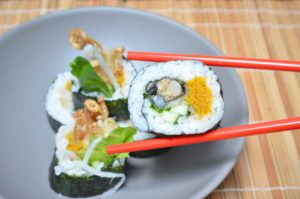 Vegan version of Spider Roll sushi. Faux roe made from amaranth. Bundled, fried enoki mushrooms replace crab